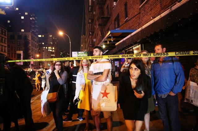 NEW YORK, NY - SEPTEMBER 17: People stand behind police lines as firefighters, emergency workers and police gather at the scene of an explosion in Manhattan on September 17, 2016 in New York City. The evening explosion at 23rd street in the popular Chelsea neighborhood injured over a dozen people and is being investigated.   Spencer Platt/Getty Images/AFP == FOR NEWSPAPERS, INTERNET, TELCOS & TELEVISION USE ONLY ==